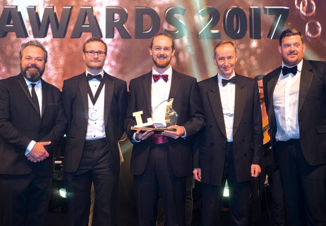 From left: Comedian and Lux Awards host Hal Cruttenden; SLL president Richard Caple; Young Lighter Matt Hanbury; and Mark Sutton Vane, judging on behalf of the LET