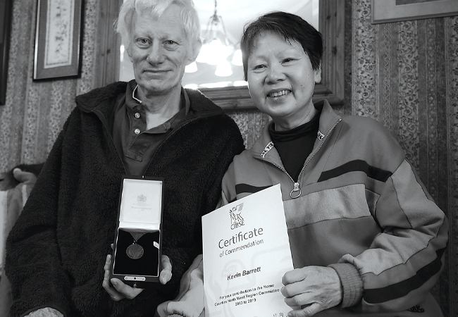 Kevin Barrett, with his wife Irene, receiving the Region's Medal and his CIBSE Certificate of Commendation